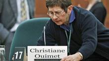 A worker makes adjusts the witness chair intended for Christiane Ouimet, the former integrity commissioner, at a Commons committee hearing in Ottawa on Feb. 8, 2011. (REUTERS)