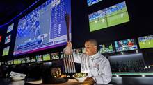 Chef Avaughn Wells stabs an oversized fork into the 67-oz. ribeye dish called 'The Hail Mary' at Real Sports Bar and Grill in Toronto. The $149.99 dish is free if eaten within an hour. (Michelle Siu for The Globe and Mail)