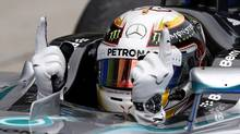 Mercedes driver Lewis Hamilton gestures in his car after winning the Malaysian Formula One Grand Prix at Sepang International Circuit in Sepang, Malaysia, Sunday, March 30, 2014. (Vincent Thian/AP Photo)