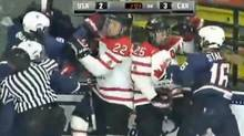 Players scuffle late in the third period of an exhibition game between Canada and the U.S. on Saturday. (YouTube video still)