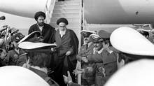 Iranian revolutionary leader Ayatollah Ruhollah Khomeini, centre, arrives in Tehran following an exile in France, Feb. 1, 1979. (GABRIEL DUVAL/AFP/Getty Images)