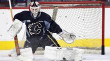 Calgary Flames goalie Miikka Kiprusoff, from Finland, makes a save during the first day of training camp in Calgary on Sunday, Jan. 13, 2013. (The Canadian Press)