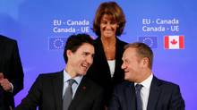 Prime Minister JustinTrudeau and European Council President Donald Tusk attend the signing ceremony of the Comprehensive Economic and Trade Agreement (CETA), at the European Council in Brussels, Belgium, Oct. 30, 2016. (FRANCOIS LENOIR/REUTERS)