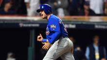 Chicago Cubs pinch-runner Albert Almora Jr. celebrates after scoring the Game 7 go-ahead run against the Cleveland Indians in the 10th inning. (Tommy Gilligan/USA Today Sports)