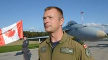 Captain David Pletz of Canada poses in front of his F-18 fighter before the visit of new NATO Secretary General at the NATO troops stationed at the Lask air base. Jens Stoltenberg said NATO would protect member Turkey against attacks from the jihadist Islamic State group, which is fighting to capture territory in Iraq and Syria near the Turkish border. (JANEK SKARZYNSK/AFP PHOTO)
