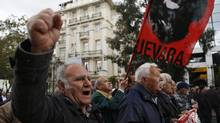 Pensioners shout slogans during a protest in central Athens, Friday, April 19, 2013. (Dimitri Messinis/AP)
