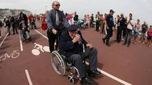 "Dieppe veteran Charles Russell Burrows, 90, of Picton in Ontario, wipes his tears during the commemorations to honor Allied soldiers killed 70 years ago in a failed World War II invasion, take place in front of the sea in Dieppe, northern France, Sunday Aug. 19, 2012. Some 1,400 soldiers were killed in ""Operation Jubilee"" when the Allies tried to briefly invade Dieppe to test German defenses. (AP Photo/Michel Spingler) (Michel Spingler/AP)"