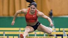 Canadian hurdler – and mom to Nataliya – Priscilla Lopes-Schliep is slowly improving her times in her quest to qualify for the London Games. (Graham Hughes/THE CANADIAN PRESS)