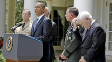 U.S. President Barack Obama announces the replacement of General Stanley McChrystal as top war commander in Afghanistan with General David Petraeus, second from right, in June. (Jason Reed/Reuters)