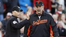 San Francisco Giants manager Bruce Bochy had suffered left-shoulder pain since last year. (JEFF HAYNES/REUTERS)