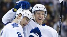 Toronto Maple Leafs defenceman's Luke Schenn, left, and Carl Gunnarsson, right, celebrate Gunnarsson's goal while playing against the Anaheim Ducks during second period NHL hockey action in Toronto on Thursday, January 20, 2011. THE CANADIAN PRESS/Nathan Denette (NATHAN DENETTE)