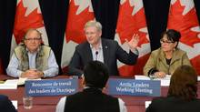 Prime Minister Stephen Harper is joined by Minister of Aboriginal Affairs Bernard Valcourt and Minister of Environment Leona Aglukkaq as they take part in a meeting with artic leaders in Rankin Inlet, Nunavut on Thursday, August 22, 2013. (Sean Kilpatrick/THE CANADIAN PRESS)