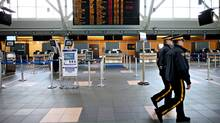 RCMP on patrol at Vancouver Intenational airport on January 12th, 2010. (Simon Hayter For The Globe and Mail/Simon Hayter For The Globe and Mail)