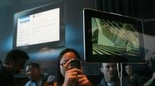 A BlackBerry DevCon attendee takes a photograph of the new RIM PlayBook this week in San Francisco (Justin Sullivan/Getty Images)