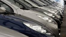 Second hand Peugeot automobiles are parked in a car dealership in Nice, southern France, October 28, 2008. (ERIC GAILLARD/REUTERS)