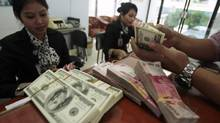 Monetary officials as far afield as South Korea, Russia, Sweden, the Czech Republic and Indonesia have signalled their readiness to join the devaluation wave to safeguard their interests. (YUSUF AHMAD/REUTERS)