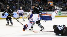 Jordan Eberle #14 of the Edmonton Oilers goes airborne after hitting Tomas Hertl #48 of the San Jose Sharks at SAP Center on March 24, 2016 in San Jose, California. (Ezra Shaw/Getty Images)
