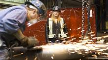 Military veteran Heather Reid is now safety co-ordinator for Supreme Steel, a steel fabrication plant in Edmonton. (Ian Jackson For The Globe and Mail)