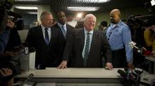 Mayor Rob Ford, arrives at the elections office at city hall to file papers to officially enter the 2014 mayoral race in Toronto, Ontario, Thursday January 2, 2014. (Kevin Van Paassen/The Globe and Mail)