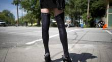 A sex trade worker is pictured in downtown Vancouver, B.C., Wednesday, June, 3, 2014. THE CANADIAN PRESS/Jonathan Hayward (JONATHAN HAYWARD/THE CANADIAN PRESS)