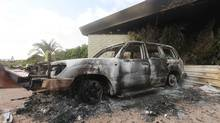 A burnt car is parked at the U.S. consulate, which was attacked and set on fire by gunmen yesterday, in Benghazi September 12, 2012. Christopher Stevens, the U.S. ambassador to Libya, and three embassy staff were killed as they rushed away from the consulate building, stormed by al Qaeda-linked gunmen blaming America for a film that they said insulted the Prophet Mohammad. Stevens was trying to leave the consulate building for a safer location as part of an evacuation when gunmen launched an intense attack, apparently forcing security personnel to withdraw. (Esam Al-Fetori/Reuters)