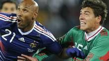 Mexico's defender Hector Moreno, right, vies with France's striker Nicolas Anelka during their Group A first round 2010 World Cup football match on June 17, 2010 at Peter Mokaba stadium in Polokwane. (OMAR TORRES/AFP/Getty Images)