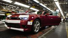 Workers at the General Motors Oshawa assembly plant work on the Camaro model Aug 28, 2013. (Moe Doiron/The Globe and Mail)