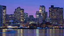 The city skyline is seen at dusk on Boston Harbor in Boston, Friday, Jan. 6, 2012. (Michael Dwyer/AP)