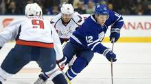 Toronto Maple Leafs forward Connor Brown (12) rushes the puck between Washington Capitals defenceman Dmitry Orlov (9) and forward Marcus Johansson (90) in the second period at Air Canada Centre in Toronto on Nov. 26, 2016. (Dan Hamilton/USA Today Sports)