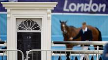 A door resembling the entrance to the home of the British prime minister stands as part of a decoration on the course for the equestrian eventing show jumping phase at the 2012 Summer Olympics, Tuesday, July 31, 2012, in London. (David Goldman/AP)