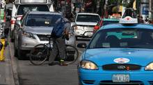 Toronto has the fifth-best score on an IBM-led survey of 'commuter pain,' ranking cities around the world based on commuting time, gas prices, ease of movement on the road and other factors. (Deborah Baic/Deborah Baic/The Globe and Mail)