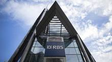 A logo sits on a sign outside Royal Bank of Scotland Group Plc's headquarters in London, U.K., on Wednesday, Feb. 19, 2014. (Simon Dawson/Bloomberg)