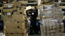 Pedraza Gonzalez sorts packages at the FedEx hub at Los Angeles International Airport on Monday, Dec. 2, 2013, in Los Angeles. (Jae C. Hong/AP)