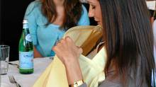Nursing covers, such as the Hooter Hider, allow women privacy when breastfeeding in public. But some argue women shouldn't feel they have to hide an activity they have a right to. (bebeaulait.com)