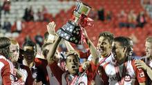 Toronto FC's Joao Plata holds the winners trophy after defeating the Vancouver Whitecaps in their 2012 Canadian Championship final soccer match in Toronto May 23, 2012. (Mike Cassese/Reuters/Mike Cassese/Reuters)