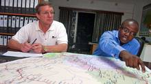Banro Corp. president and CEO Mike Prinsloo, left, and vice-president of exploration Dan Bansah discuss the company's gold mining project in the eastern Congo at their offices in Bukavu. (Erin Conway-Smith/Erin Conway-Smith/The Globe and Mail)