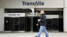 A pedestrian walks past the TransAlta building in downtown Calgary, in this file photo. (Jeff McIntosh/The Canadian Press)
