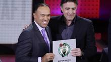 NBA Deputy Commissioner Mark Tatum poses for photographs with Boston Celtics co-owner Wyc Grousbeck after the Celtics won the first pick in the NBA draft in New York, on Tuesday, May 16, 2017. (Frank Franklin II/AP)