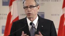 Canada's Finance Minister Joe Oliver speaks to reporters during a news conference at the North American Energy Summit in the Manhattan borough of New York, June 10, 2014. The Conservative government will announce Thursday that it is lowering Employment Insurance premiums in an effort to boost hiring at a time of sluggish job growth – the first of an expected series of tax cuts as Ottawa moves out of deficit and prepares to face voters in next year's federal election. (ADAM HUNGER/REUTERS)