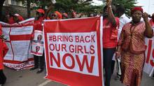 In this file photo taken Tuesday, Oct. 14, 2014, people demonstrate calling on the Nigerian government to rescue girls taken from a secondary school in Chibok region, in the city of Abuja, Nigeria. Suspected Boko Haram mlitants have kidnapped 25 girls from a northeastern Nigerian town. (Olamikan Gbemiga/AP)