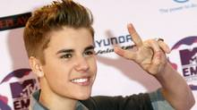 Canadian pop star Justin Bieber poses on arrival on the red carpet at the MTV Europe Music Awards show in Belfast November 6, 2011. (LUKE MACGREGOR/REUTERS/LUKE MACGREGOR/REUTERS)