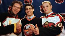 The top three 2000 NHL draft picks from left to right, Dany Heatley, left, picked second by the Altanta Thrashers, Rick DiPietro, centre, picked first by the New York Islanders, and Marian Gaborik picked third by the Minnesota Wild, give a thumbs up. (Jeff McIntosh)