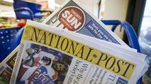 Toronto Sun and National Post newspapers are posed in front of a newsstand in Toronto on Oct. 6, 2014. (MARK BLINCH/REUTERS)