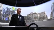 Donald Ross stands in Toronto Rehab's street lab, which allows patients using mobility devices to navigate a virtual streetscape. (Fred Lum/The Globe and Mail)