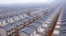 Well, at least they aren't stacking Canadian homes like this gigantic Chinese subdivision at the Dadun village of Lingshui ethnic Li Autonomous County, Hainan province. (STRINGER/CHINA/REUTERS)