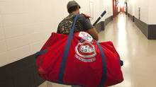Montreal Canadiens' Francis Bouillon arrives for an informal training session at the Canadiens' training facility in Brossard, Que., Monday, September 17, 2012 on day two of the NHL lockout. (The Canadian Press)