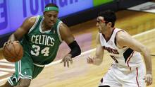 Boston Celtics forward Paul Pierce drives against Atlanta Hawks guard Kirk Hinrich in the first half of their NBA Eastern Conference playoffs basketball game in Atlanta on Tuesday. (TAMI CHAPPELL)