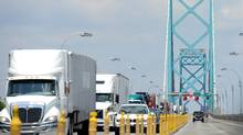 The Ambassador U.S./Canada bridge and border crossing at Windsor, Ont. and Detroit, MI on July 11, 2014. Ottawa is unleashing a lobbying blitz in the U.S. in effort to spare Canadian trade. (Stephen C. Host/The Canadian Press Images)