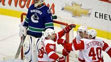 Vancouver Canucks goaltender Roberto Luongo looks on as the Detroit Red Wings celebrate a goal during first-period NHL hockey action in Vancouver on October 27, 2009. (DARRYL DYCK)