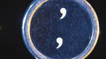 A comma key (Comstock Images)
